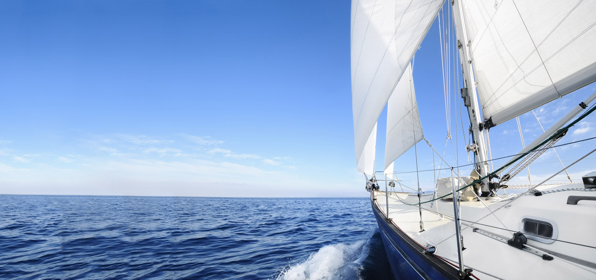 Sail boat in the middle of the ocean